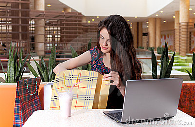 Young woman with a laptop at cafe