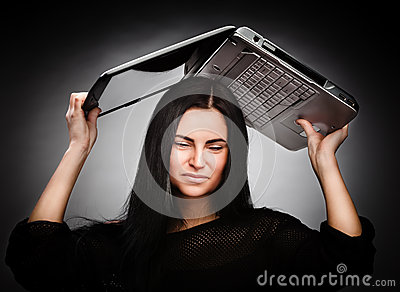 Young woman with a laptop on her head