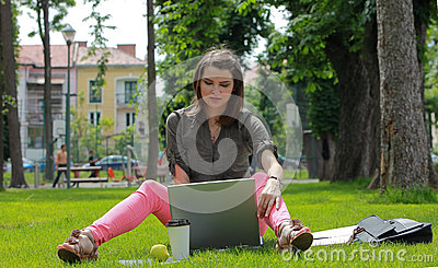 Young Woman with a Laptop in the Park