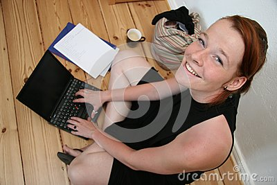 Young woman with laptop smilin