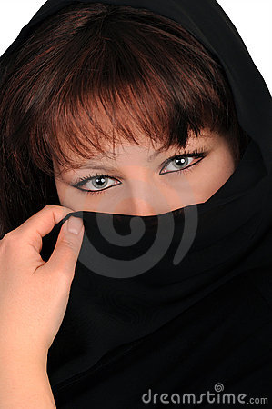 Young woman latent by a black veil