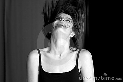 Young woman laughing and throwing her head back.