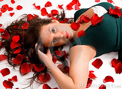 Young Woman Laying in Rose Petals