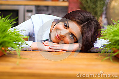 Young woman laying on the table with flowers on it
