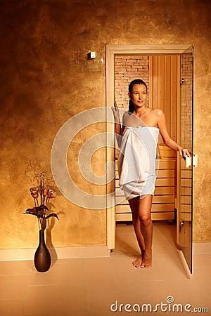 Young woman leaving sauna