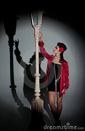 Young woman and lightpole