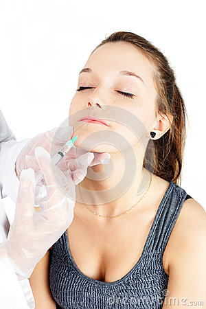 Young woman lip injection