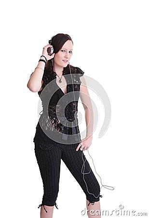 Young woman listening headphones