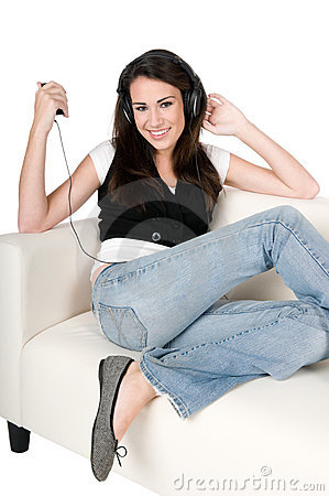 Young woman listening to music, isolated