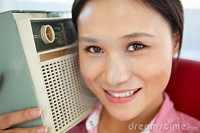 Young woman listening to radio