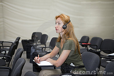 Young woman listens in audience