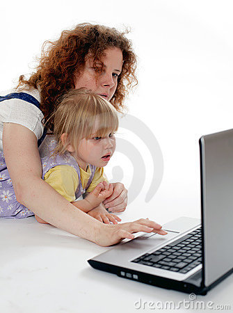 Young woman with little girl looking at laptop