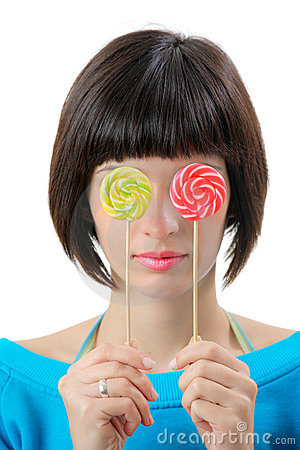 Young woman with lollipops