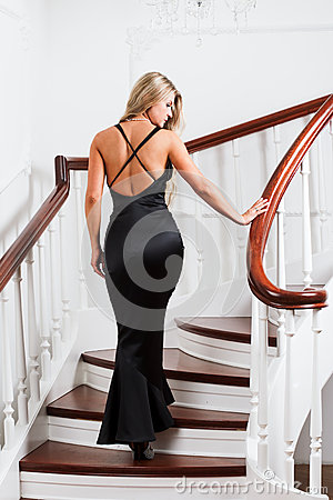 Young woman in a long black dress
