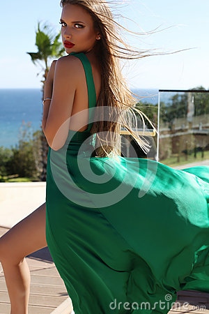 Young Woman With Long Blond Hair In Luxurious Green Silk Dress Stock Photo Image 58303187