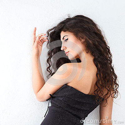 Young woman with long curly hair