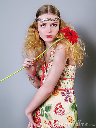 Young woman with long hair and flowers