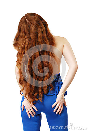 Young woman with long red hair waved