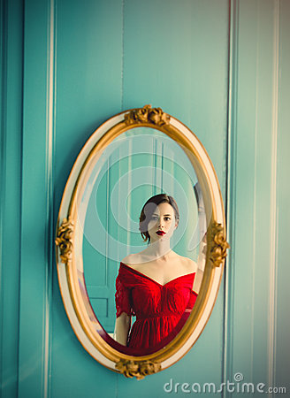 Free Young Woman Looking At Mirror Stock Photo - 91962790