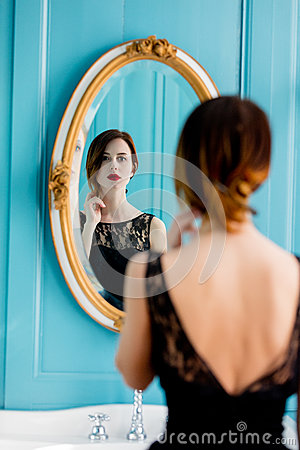 Free Young Woman Looking At Mirror Stock Images - 91962964