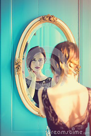 Free Young Woman Looking At Mirror Royalty Free Stock Image - 91963036