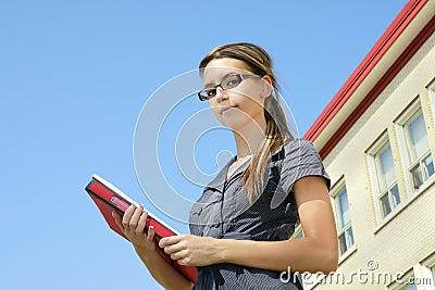 Young woman looking down at camera