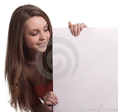Young woman looking down a white sign
