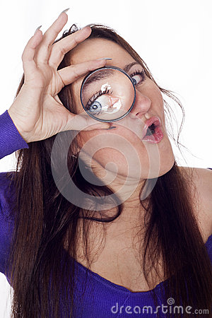 Young woman looking through loupe