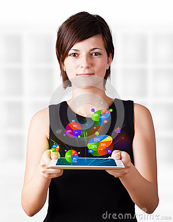 Young woman looking at modern tablet with pie charts
