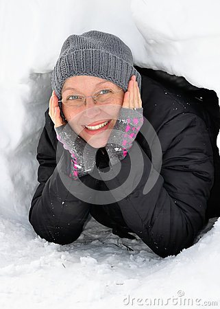 Young Woman Looking out of an Igloo Entrance