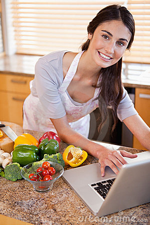 A young woman looking for a recipe on the internet