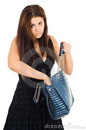 Young woman looking for smth in her bag