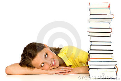 Young woman looking at stack of books