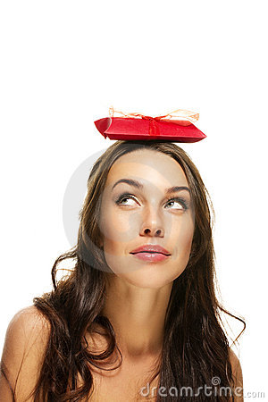 Young woman looking to the present on her head