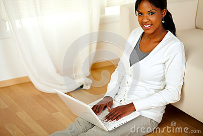 Young woman looking at you browsing the Internet