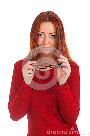 Young woman looking at you with glasses in hands