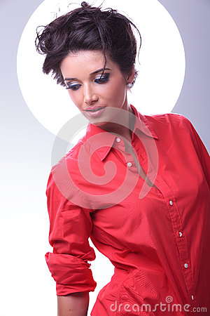 Young woman looks down with aura behind