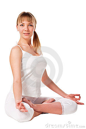 Young woman in the lotus pose