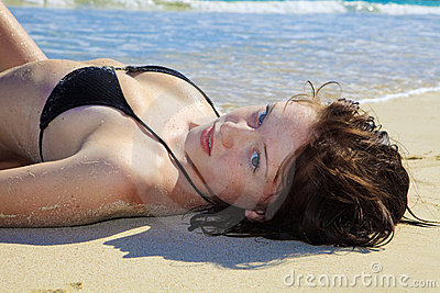 Young woman lounging at the beach