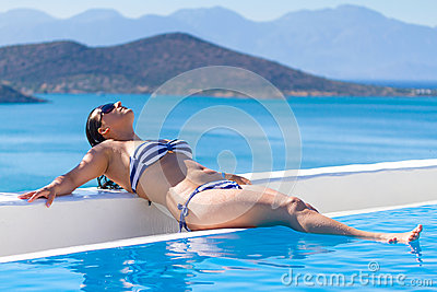 Young woman at lovely swimming pool