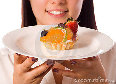 Young woman with low-calorie fruit cake