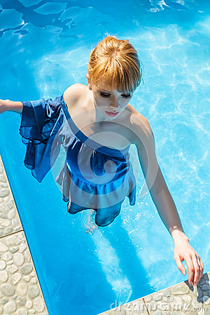 Young woman in luxurious blue dress stock photo image 32083720 for Can u get pregnant in a swimming pool