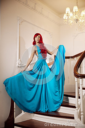 Red hair blue dress