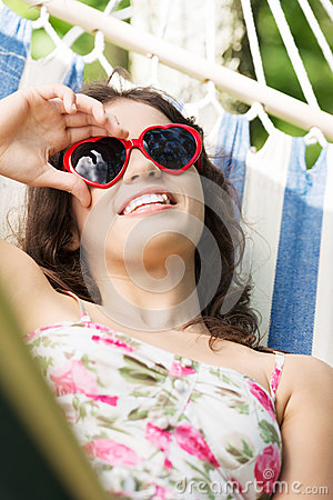 Free Young Woman Lying In A Hammock Stock Photography - 31979472