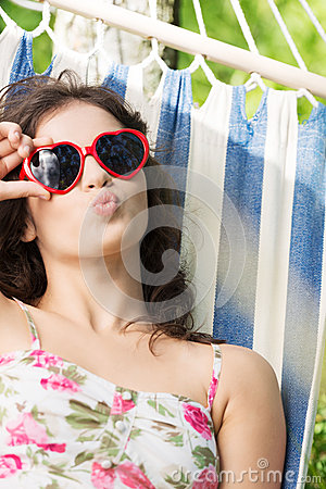 Free Young Woman Lying In A Hammock Stock Photos - 31979473