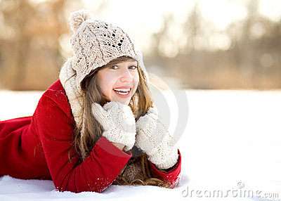 Young Woman Lying in the Snow