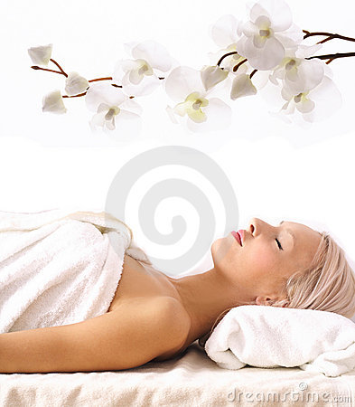 Young woman lying at spa