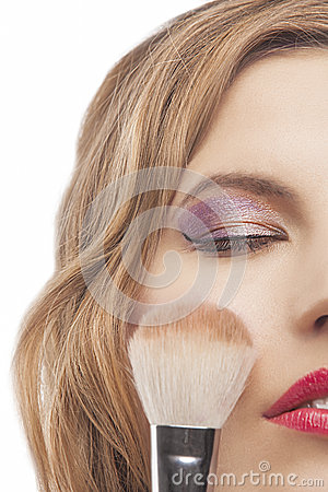 Young woman with make-up brush