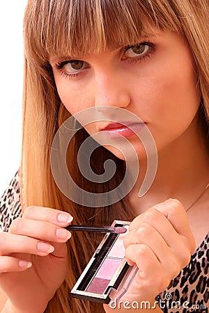 Young woman make up her eyebrow
