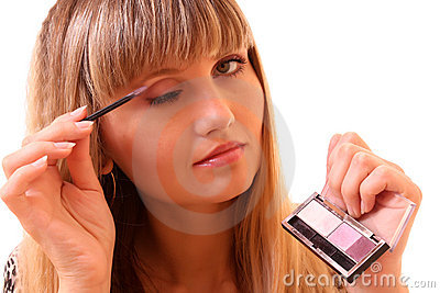 Young woman make up her eyebrow isolated
